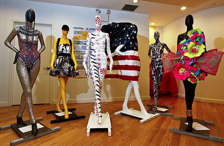designer mannequins displayed each uniquely decorated